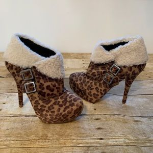 Leopard print boots with Sherpa trim. Size 7